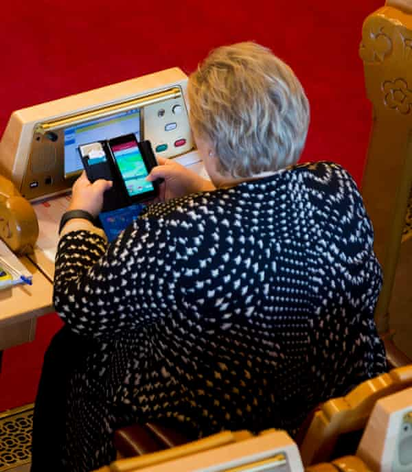 Erna Solberg, the prime minister, playing Pokémon Go in Norway's parliament.