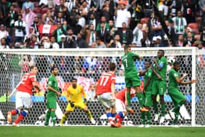 Aleksandr Golovin of Russia scores his sides fifth goal from a free kick