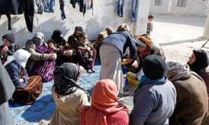 Displaced people gather in Aleppo, Syria. Many refugees could be prevented from entering the US despite judicial action against Trump's travel ban.