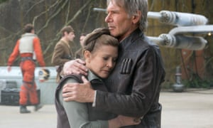 Carrie Fisher as Leia Organa embraces Harrison Ford's Han Solo in Star Wars: The Force Awakens.