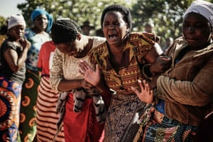 Suspicious Ziyambi, widow of Ishmael Kumire, reacts during her husband's funeral after he was shot during post-election violence in Harare.