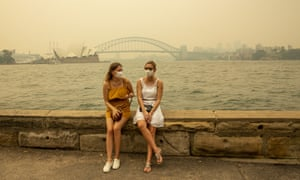 German tourists wearing face masks against the smoke in Sydney, Australia, earlier this month.