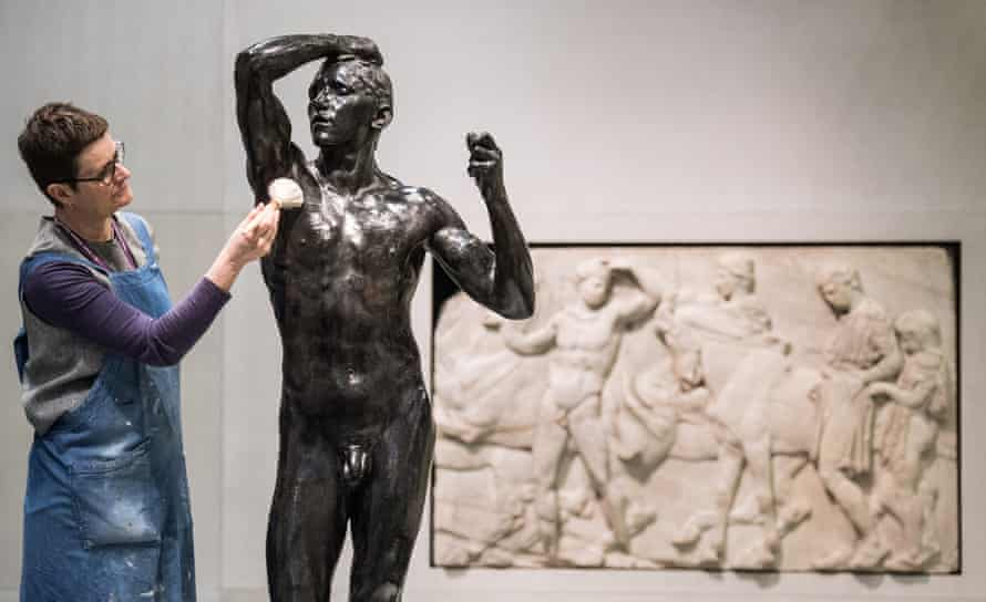 A conservator from the British Museum working on Rodin's The Age of Bronze, 1877, alongside Unmounted Youth Preparing for the Cavalcade from the Parthenon, April 2018.