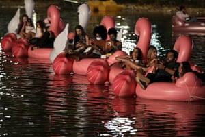 Brasilia, Brazil Spectators lounge on inflatable unicorns and flamingos as they watch a movie during the first Floating festival, an aquatic version of a drive-in cinema, in Brasilia