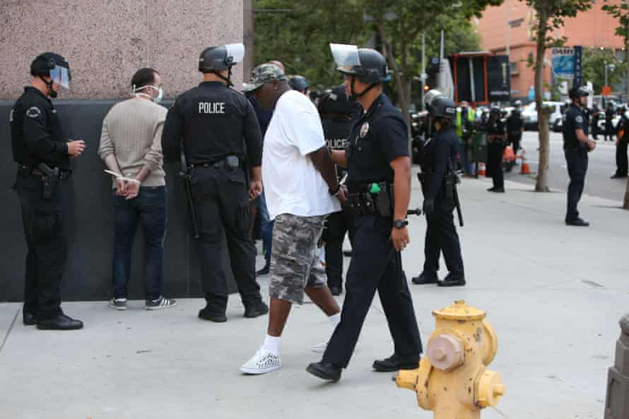 A man is taken into custody during a Black Lives Matter protest in downtown Los Angeles on 2 June 2020.