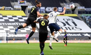 Eric Dier and Andy Carroll compete for a high ball in the incident that led to a controversial penalty that gave Newcastle a 1-1 draw.