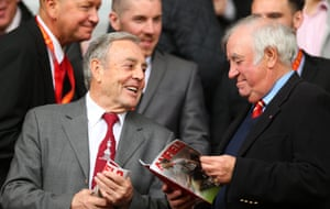Chatting with the comedian Jimmy Tarbuck before a match between Liverpool and Tottenham at Anfield.
