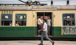 Indian passengers travel on a local train