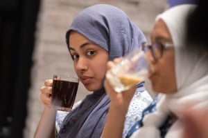 Amina Ahmad, 21, enjoys tea with friends after breaking fast at sundown in the Remas Restaurant in Hamtramck.