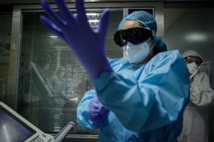 Santa Cruz de Tenerife, Spain. A paramedic puts on protective clothing as he prepares to treat a patient with coronavirus at Nuestra Señora de la Candelaria hospital in Canary Islands. The medical centre took a central role during the first wave of the virus in February