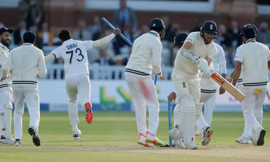 India's Mohammed Siraj runs off with a stump as Jimmy Anderson stands by his broken wicket after being England's last man dismissed