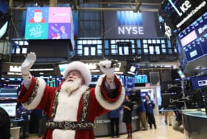Santa Claus pays a visit on the floor at the New York Stock Exchange (NYSE) in New York, U.S., November 21, 2018.