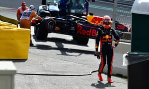 Max Verstappen walks away from his Red Bull after crashing out at Spa-Francorchamps.