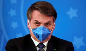 Brazil's President Jair Bolsonaro is pictured with his protective face mask at a press statement during the coronavirus disease outbreak in Brasilia.