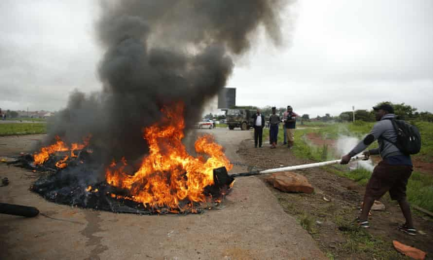 A protester burns tyres in Harare