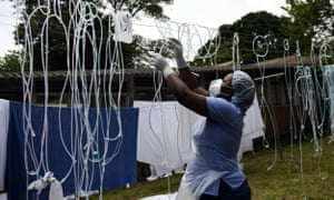 A health worker dries decontaminated nasal prongs and oxygen face masks at Queen Elizabeth Central Hospital in Blantyre. Malawi faces a resurgence of Covid-19 that is overwhelming the country where a presidential residence and a national stadium have been turned into field hospitals in efforts to save lives.