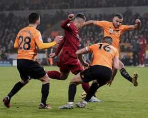 Firmino scores Liverpool's second goal against Wolves at Molineux on 23 January. All eight of his league goals this season have come away from Anfield.