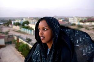 Nadra, 20, an international development student, looks over the city.