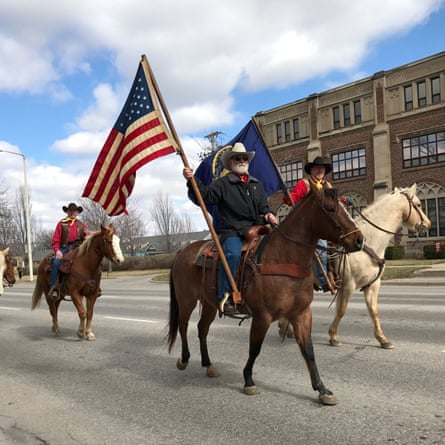 A procession of horse travelling through Lincoln, Nebraska, to celebrate the state's 150th anniversary