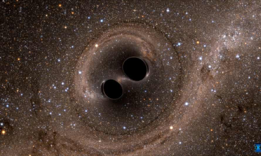 Η σύγκρουση δύο μαύρων οπών - ένα συμβάν που εντοπίστηκε για πρώτη φορά από το Laser Gravitational Wave Observatory ή το Ligo - εμφανίζεται σε αυτήν την ακίνητη εικόνα από μια προσομοίωση υπολογιστή.