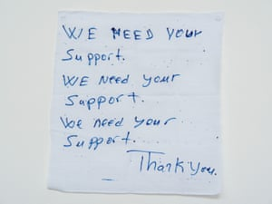 'We need your support': A hand written note from a detainee on Manus Island.