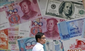 a man passes a billboard displaying oversize yuan notes