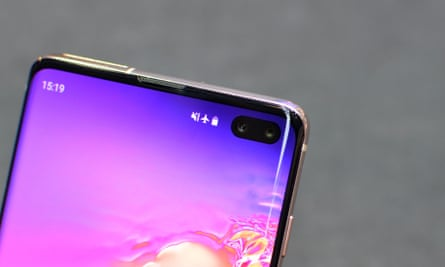 The two selfie cameras poke through a small oval-shaped cut out in the screen of the Galaxy S10+.