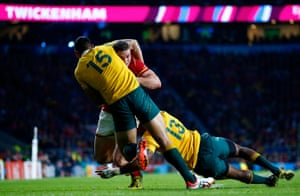 An example of Australia's defensive fortitude as George North is stopped by Israel Folau and Tevita Kuridrani.