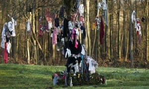 Masks hang on trees in northern France to banish COVID-19