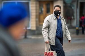 A masked man in Uppsala, Sweden, last month.