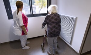 A resident and staff member in a care home