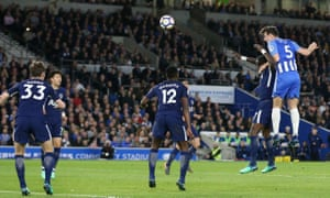 Brighton's Lewis Dunk rises highest and powers a header at the Tottenham goal.
