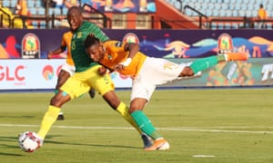 Jonathan Kodjia (right) scores the only goal of the game to give Ivory Coast the points against South Africa in Cairo.
