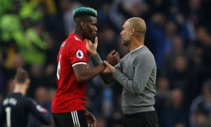 Pep Guardiola and Paul Pogba after the match.