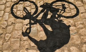 A rider's shadow is cast on cobblestones on stage nine of the 2020 Tour de France