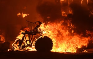 An all-terrain vehicle burns during a wildfire. California is gripped by a record-breaking heatwave