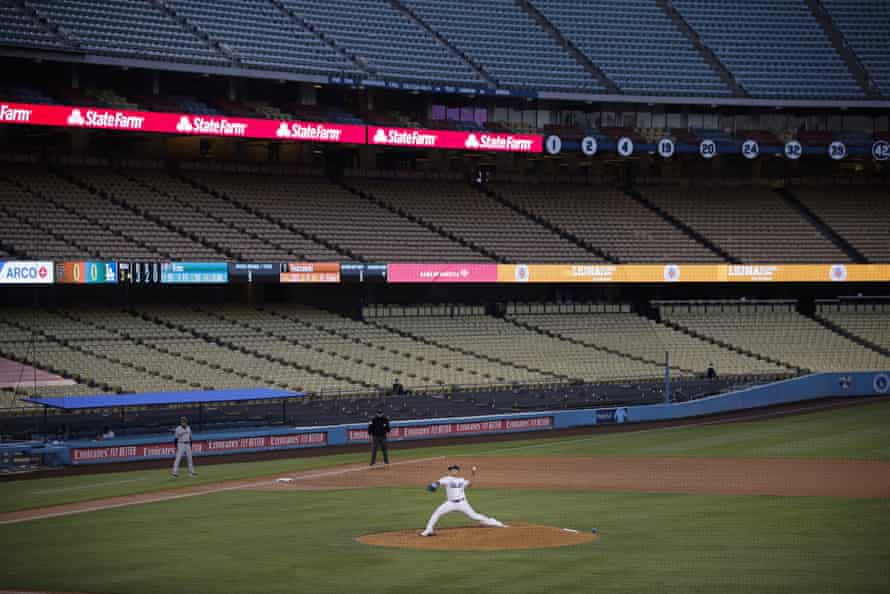 With the seats at Dodger Stadium empty, Los Angeles Dodgers starting pitcher Julio Urias throws to a San Francisco Giants batter during the third inning of a baseball game on 26 July.