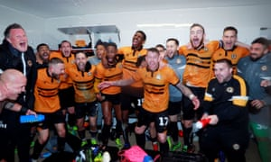 Newport County players celebrate in the dressing room after the match
