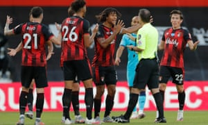Bournemouth players surround the referee in protest at a decision to disallow a late strike for handball.