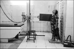 An elderly woman stands for a chest X-ray at the Shakir Ali Kahn hospital. She survived exposure to the toxic gas cloud released by the explosion at the Union Carbide chemical plant 35 years ago.