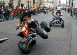 A motorcycle stunt rider takes part in the annual New Years Day Parade in London