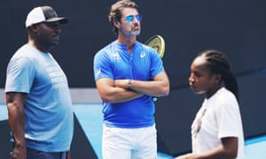 Coach Patrick Mouratoglou (centre) with Coco Gauff at the Australian Open in January.