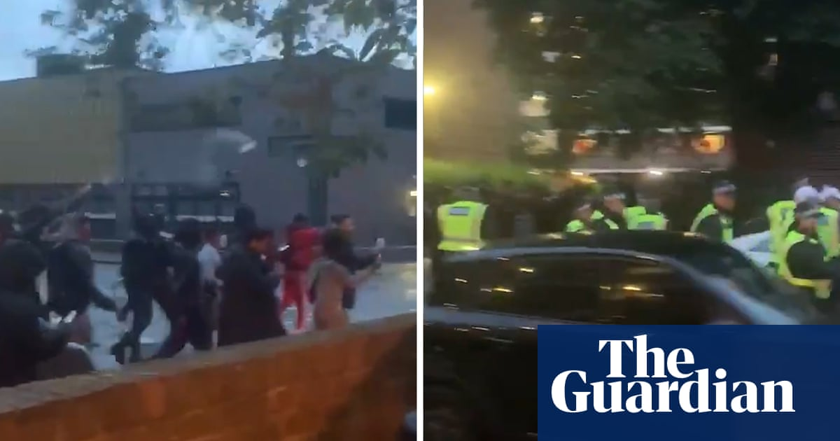 Police officers attacked by crowds at illegal White City music event – video - the guardian