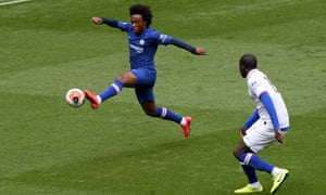 Willian takes flight in training at Stamford Bridge.
