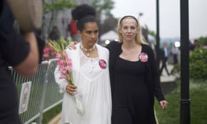 Accuser Lili Bernard (left) walks with Caroline Heldman outside the Montgomery County courthouse. They both wore large buttons which read 'We stand in truth'.
