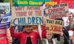 children with protest banners