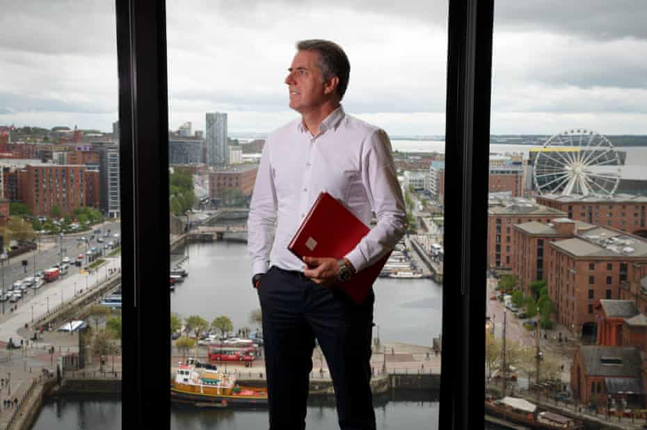 Steve Rotheram, the Metro Mayor for Liverpool in his office overlooking the waterfront area.