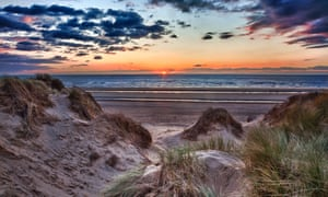 Sunset over Formby Beach through dunes.