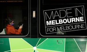 A person is seen wearing a mask on a tram on in Melbourne.