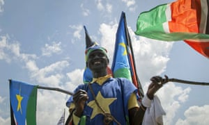 A man flags during peace celebrations in Juba, South Sudanese capital